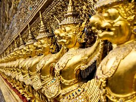 picture of garuda  - Golden Garuda statues surrounding Wat Phra Kaew temple at the Grand Palace in Bangkok, Thailand. ** Note: Shallow depth of field - JPG
