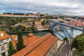 image of dom  - Dom Luis I bridge in Porto in Portugal in a summer day - JPG