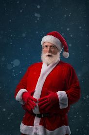 picture of big belly  - Fat Santa Claus touching his big belly - JPG