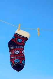 picture of clotheslines  - Odd socks hanging on a clothesline on a sky background - JPG