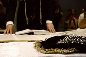 foto of torah  - ceremony reading the parchment Torah scroll with a man - JPG