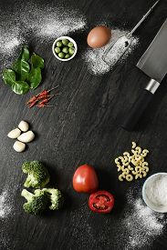 picture of cassia  - Thai food background with tomatoes Siamese Cassia basil Lemon Leaf Kaffir lime leaf spaghetti garlic chilli powder parsley eggs and knife - JPG