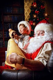 stock photo of letters to santa claus  - Santa Claus in his everyday clothes in Christmas home d - JPG