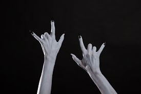 image of pale skin  - Pale monster hands showing heavy metal symbol - JPG