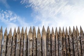 picture of stockade  - Wooden palisades form a defense barricade ti stop intruders in medieval times - JPG