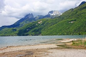 stock photo of annecy  - shores of Lake Annecy in the spring in France - JPG