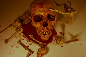 stock photo of skull cross bones  - SKELETON AND SKULLS BLOOD SPLASH HALLOWEEN FESTIVAL - JPG