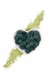 stock photo of chlorella  - Chlorella spirulina and wheatgrass. Green superfood detox healthy living ** Note: Soft Focus at 100%, best at smaller sizes - JPG