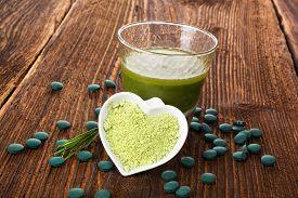 stock photo of chlorella  - Spirulina chlorella barley and wheatgrass - JPG