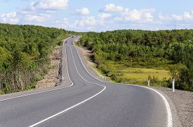 pic of murmansk  - Asphalt road among the hills on the Kola Peninsula from Murmansk to the border with Norway summer time - JPG