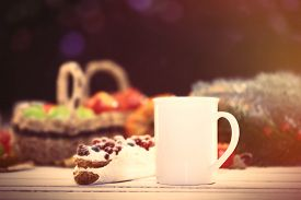 stock photo of eclairs  - Eclair and cup of coffee on wooden table - JPG
