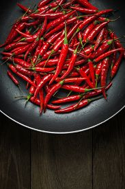 pic of red hot chilli peppers  - Red Hot Chili Peppers in old pan on rusty steel background - JPG