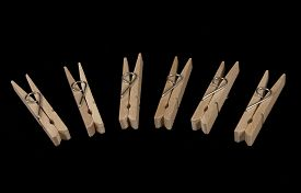 stock photo of pegging  - Closeup on wooden clothes - JPG