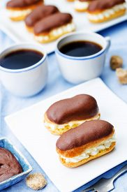 picture of eclairs  - eclairs with cheese cream and chocolate glaze on a blue background - JPG