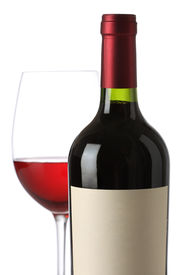 stock photo of red wine  - Red wine bottle with and empty label and glass - JPG