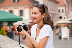 pic of analogy  - Gorgeous young brunette woman using analog camera - JPG