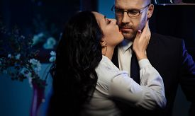 picture of office romance  - Kissing couple - JPG