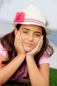pic of ten years old  - Nice child girl ten year old with a hat on the street - JPG