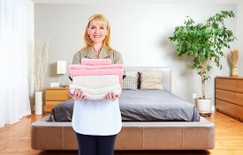 stock photo of maids  - Maid woman with towels - JPG