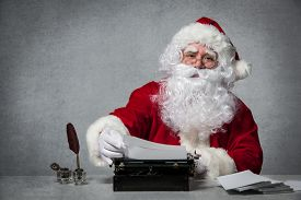 picture of letters to santa claus  - Santa Claus typing a letter on an old typewriter - JPG