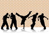image of hip hop dancers. Silhouettes on the background of wall