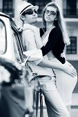 Young couple with a retro car.