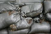 stock photo of disaster preparedness  - Sandbags dams a flood protection of construction site