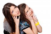 Two emotional girls teenagers. Isolated over white background.