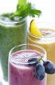 a selection of fresh fruit and vegetable smoothies