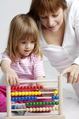 mother and child with abacus