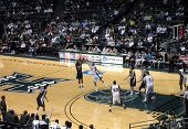 Nevada Player Takes Shot As Uh Player Tries To Block Shot.