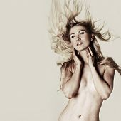 naked woman shakes hair