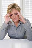 senior woman in 50s having headache