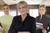 business team of three senior businesswomen at the office
