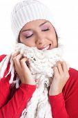 beautiful woman wearing woolen hat and scarf in winter