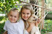 preschool children playing with cute dog