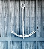 anchor on a rustic background - French island - blue sepia