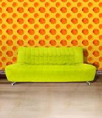 Lime green couch against poppy flower orange wallpaper and light brown concrete floor. Digital illustration from my images and designs.
