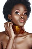 beautiful south African woman with bronze necklace and natural make-up, long false eyelashes, with l