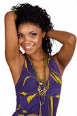 Beautiful African woman with long curly hair in purple halter neck dress and purple make-up