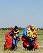 Two parachutists after landing