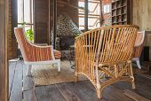 Rattan Chair And Arm Chair In Country Loft Interior Design Room. Interior Design Room Include Firepl poster
