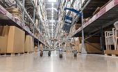 Warehouse Storage Of Retail Merchandise Shop. Trolley Shopping Cart Between Dry Grocery Shelf Sectio poster