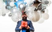 Happy Birthday Guy Holds Helium Balloons And Gift Box. Handsome Man Celebrating Something. Bearded M poster