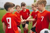 Happy Boys Play Team Sport. Kids Smiling In School Sports Team. Junior Sports Teamwork; Kids Put Han poster