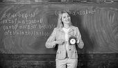 Woman Teacher Hold Alarm Clock. She Cares About Discipline. Time To Study. Welcome Teacher School Ye poster