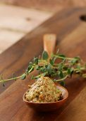 French mustard sauce in a wooden spoon