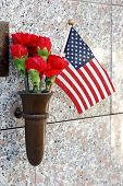 Flowers And American Flag At Crypt poster