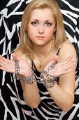 Sensual Blonde Stretches Out Her Hands In Chains
