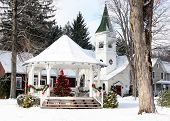 picture of winter scene  - a winter scene of a gazebo decorated for the holidays with a chruch in the background - JPG
